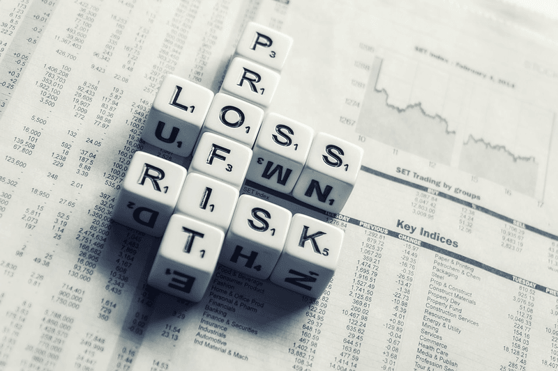 dices over newspaper spelling profit loss and risk