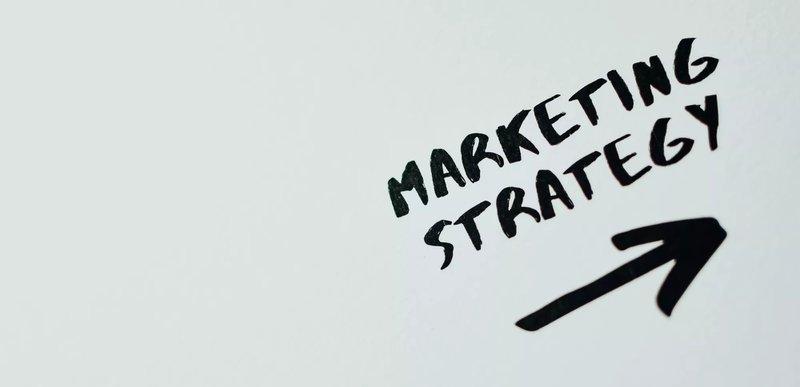 marketing strategy written on a grey background