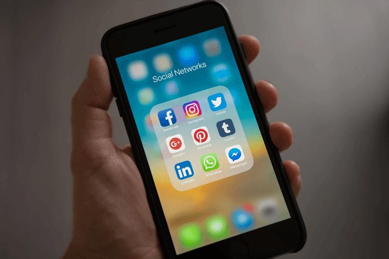 social media app icons on a phone screen